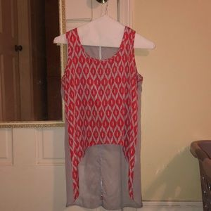 A fashionable tank top with a see through back.
